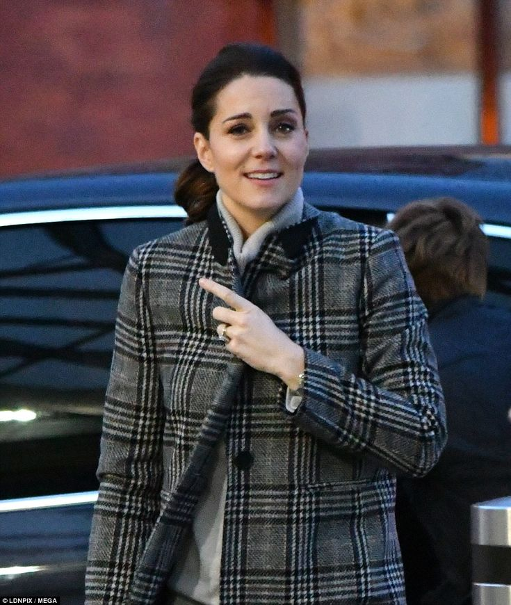 The Duchess of Cambridge made a low-key appearance at Kings Cross St Pancras on Friday morning Dec 1 2017. Casual, grey black plaid coat, hair pony tail. Catherine