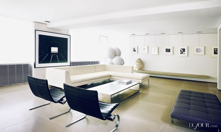 Living Room, from left: Hiroshi Sugimoto's Radio City Music Hall (1978); Paul McCarthy's White Snow Balloon Dog (2013); Noh Sang-Kyoon's For The Worshipers Buddha–Rainbow (2003); vintage prints by Edward Steichen, Walker Evans, E.J. Bellocq, Paul Strand, Man Ray, Edward Weston and Man Ray. B&B Italia sofa; Poul Kjaerholm easy chairs and daybed; Michael Gabellini coffee table.