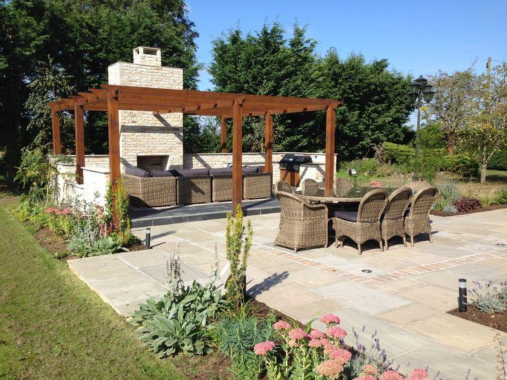 Spectacular Country garden contemporary garden design curved terrace sandstone paving