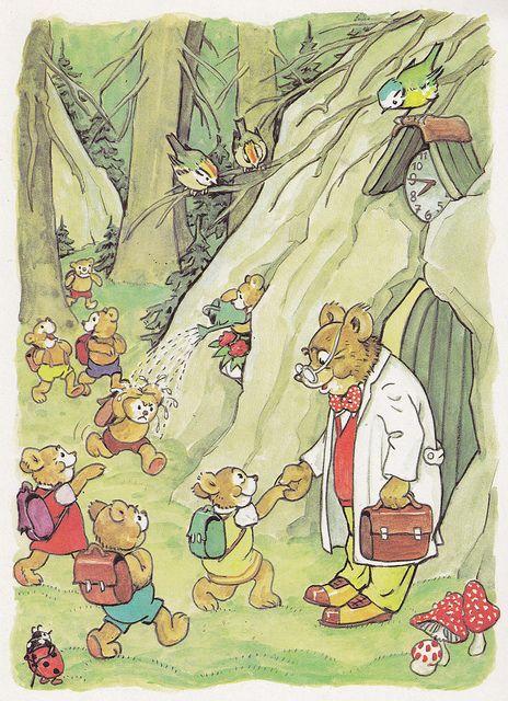 Describa lo que están haciendo los osos en el bosque