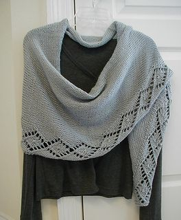 """Acadian can be worn as a shawl or a scarf. It is knitted tip to tip. The model is knit in worsted weight, but you can use any weight yarn you like, though you may need to knit more or less repeats to get the desired length and your yardage requirements will vary. The model is 76"""" long by 18"""" deep. Longer is better with this shawl!"""
