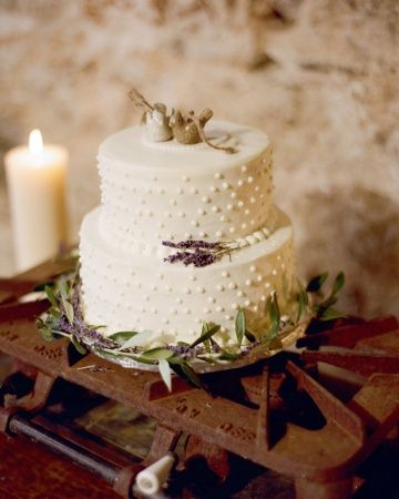 A rustic bird cake topper for a barn wedding