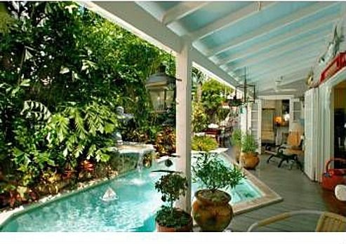 love the way the pool comes up under the porch.
