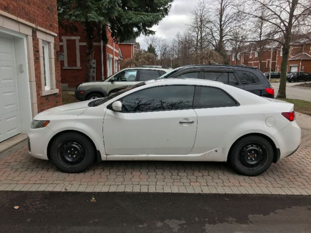 2.4l kia forte koup sx, 6 speed manual, sunroof, all leather fully loaded 162,500km drives like new, well maintained. comes with brand new all season tires (on original rims) as well as winter tires with rims. selling because i'm moving to the us. $6800 obo