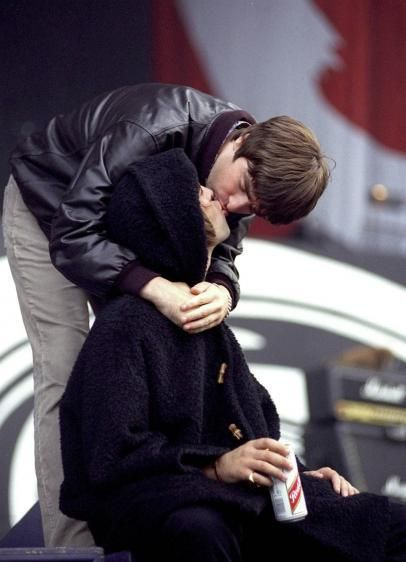 Noel and Liam Gallagher kiss