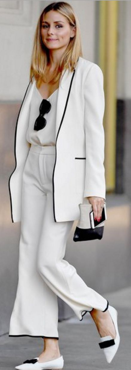Who made Olivia Palermo's black sunglasses, white jacket, tan clutch handbag…