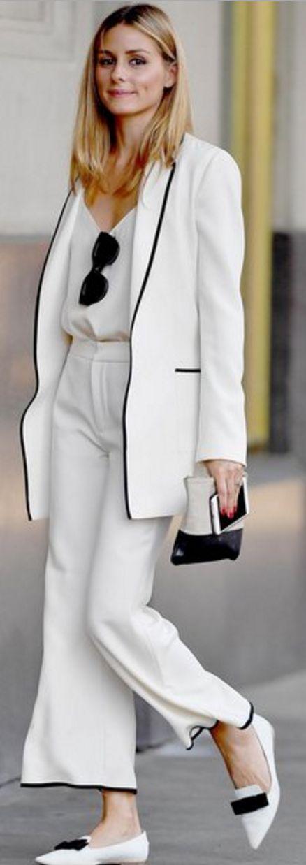 Who made Olivia Palermo's black sunglasses, white jacket, tan clutch handbag…