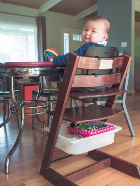 TROFAST storage box slides perfectly into the pre-slotted rails of a Stokke Tripp Trapp high chair - good to know!