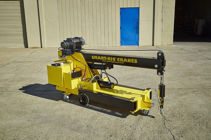 Microcranes, Inc. S1 Model Smart-Rig Crane compact. Mini crane is narrow to fit through standard doorway entry ways and aisles. Easy to transport in confined spaces and limited access areas indoors or outdoors.