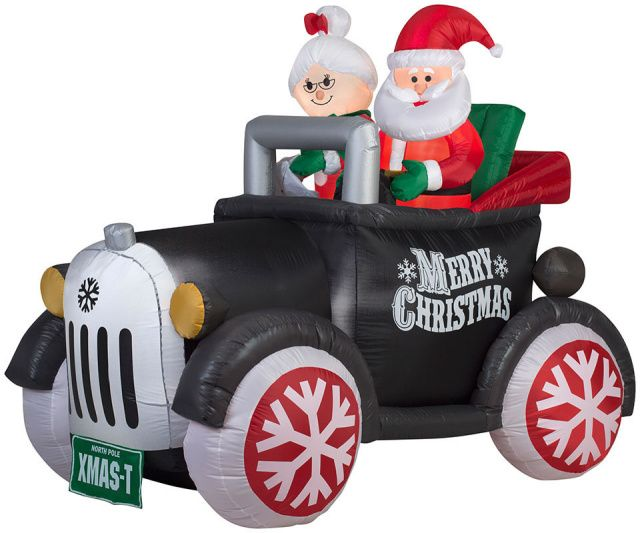 Mr. and Mrs. Claus in Antque Car Christmas Inflatable.  Look who's coming to town in his new 2016 Vintage Style Model XMAS T.