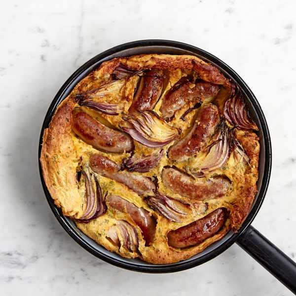 Toad in the hole with roast red onions: This classic toad in the hole recipe includes roast red onions and homemade gravy. It's easy to make and on the table in less than an hour