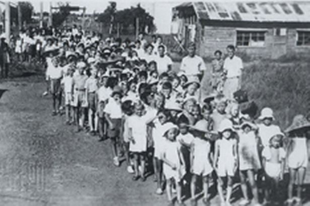 Children interned in Japanese camps during the war, taken from the book Stolen Childhoods