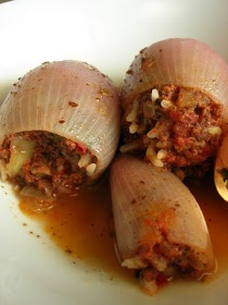 Stuffed Onions (Soğan Dolması)   A delicious & simple, Turkish Peasant dish. Since this is good right out of the oven or at room temperature, I often make this when not everyone is able to sit down at the same time-  like an open house etc....