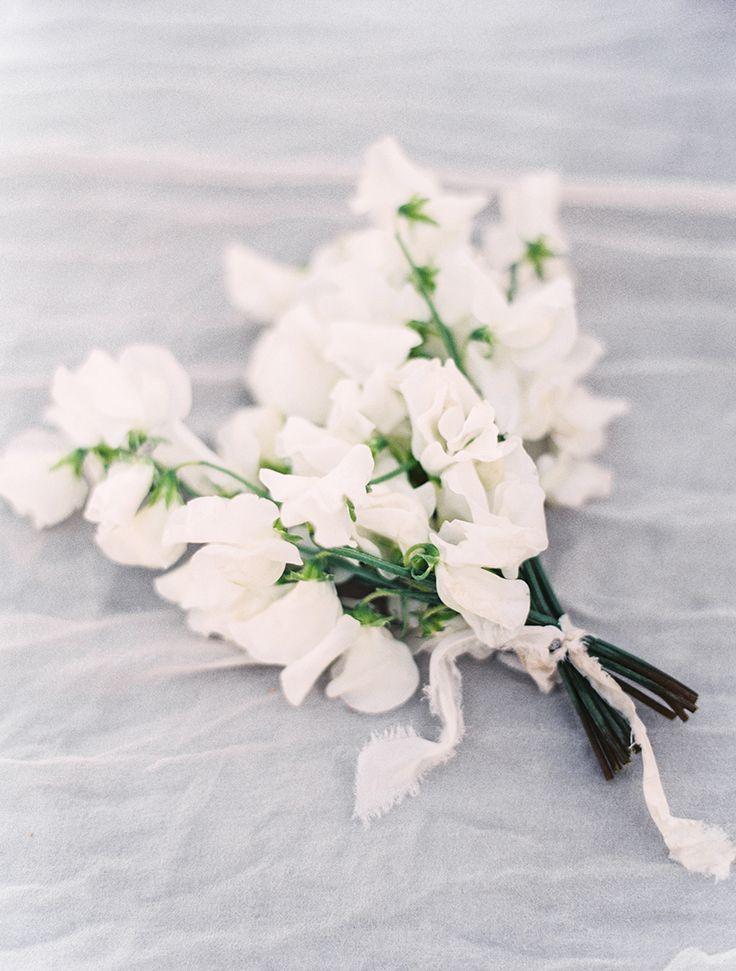 Photography: Sally Pinera - http://www.stylemepretty.com/portfolio/sally-pinera Floral Design: Poppy Design Co. - http://www.stylemepretty.com/portfolio/poppy-design-co   Read More on SMP: http://www.stylemepretty.com/2016/01/19/coastal-winter-white-wedding-inspiration/