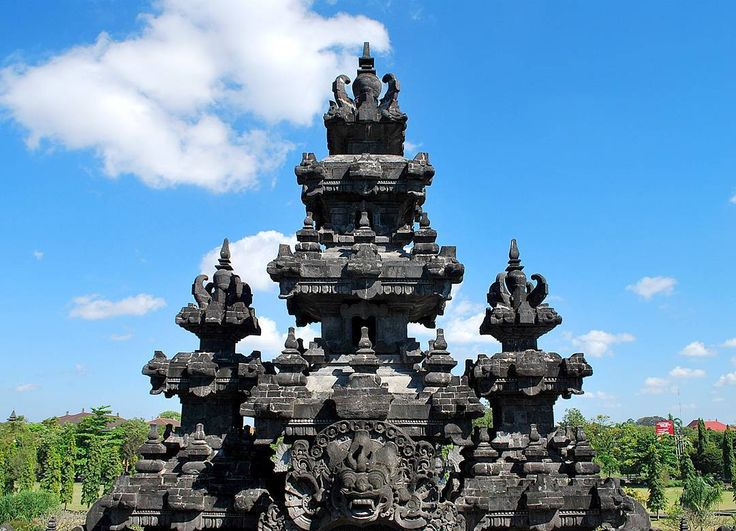 One of Bali's prominent features are always the fascinating Pura's or Temples that can be seen an over the Island of God's.  These Balinese Pura's are also one of the most photographed places in Bali as many of them are different and unique each having a meaning.  I captured this photo many yeas ago in 2008 before the dawn of social media and birth of influencers during one of my exploration trips around Denpasar. . . . .  #bali #wonderfulindonesia #tripofwonders #travel…