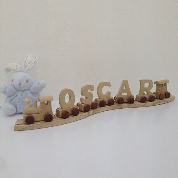 This personalised<strong>wooden name train</strong>is a great gift to commemorate a baby's birth, Christening, Naming Day, Christmas, birthday and more.  This is a very high quality item and comes with a train engine for the front, a carriage to the rear, letters on wheels in between, several lengths of train track, and a cloth pouch to keep it all in when not put on display.  The exact length of track provided will be determined by the number of letters in your chosen name. 2-3 letter…