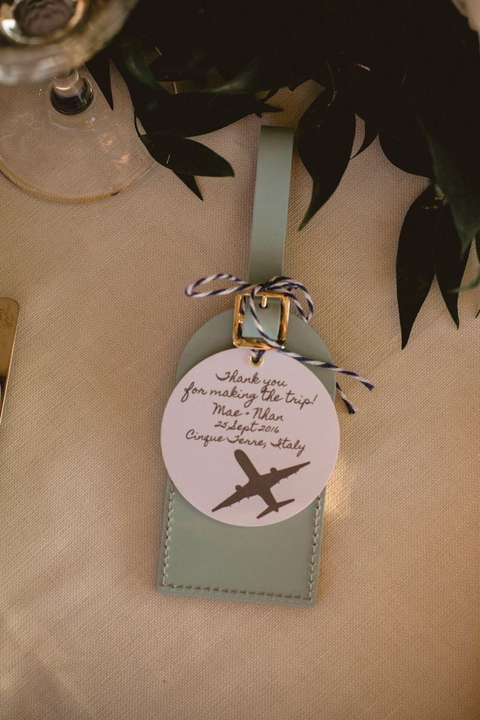 Sage green luggage tags wedding guest favors | Image by Serena Cevenini Photography
