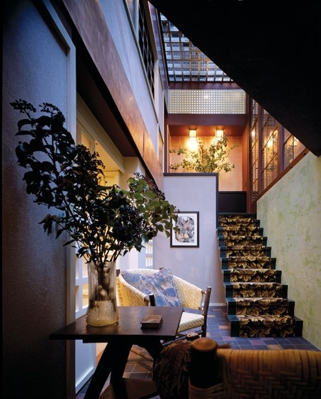 A New York house inspired by nature.    A mix of autumnal colours, floral fabrics (as with the custom carpet on the the stairs) and actual plants create an outside-inside feeling in this Manhattan townhouse.