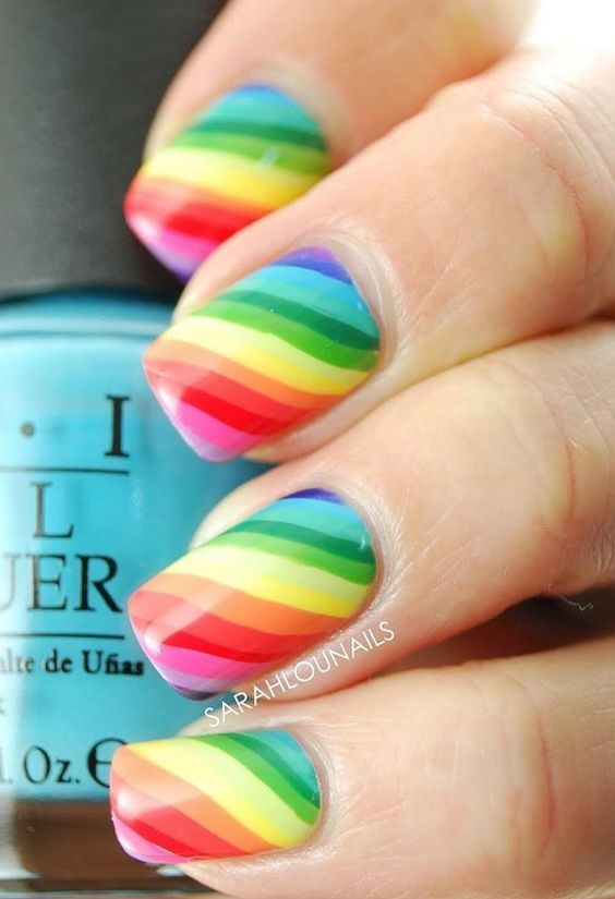 This colorful rainbow nail art will help you stand out wherever you go