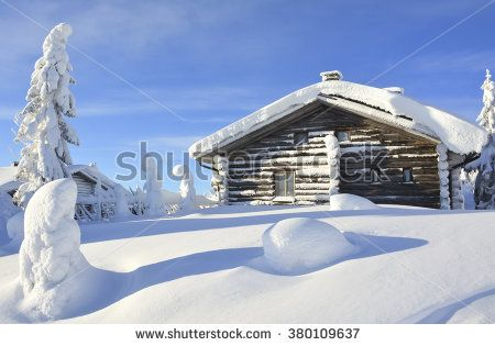 Cottage on snowy mountain on a sunny winter day - stock photo