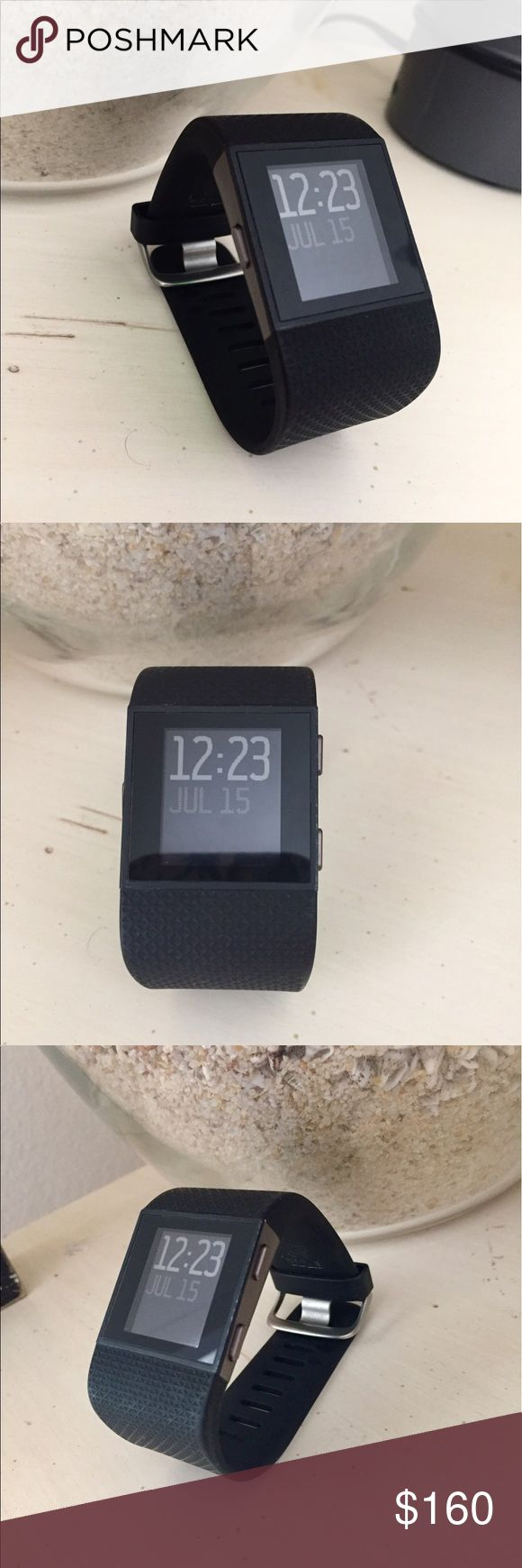 Fitbit Surge! Size small black Fitbit surge. Comes with original box and charger. Great condition, VERY minor white scratch on side edge as seen in photo. Nothing wrong with it, just looking to get a different smaller watch. GPs tracking, heart rate, activity tracker, Smart-Track multi sport, sleep tracker, auto sleep and alarms, notifications for call and text, wireless syncing ETC! fitbit Accessories Watches