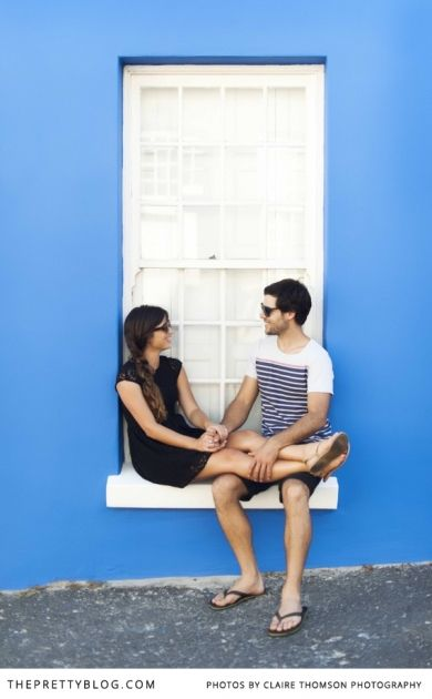 Fun couple shoot photographed against blue wall | Photographer: Claire Thomson Photography