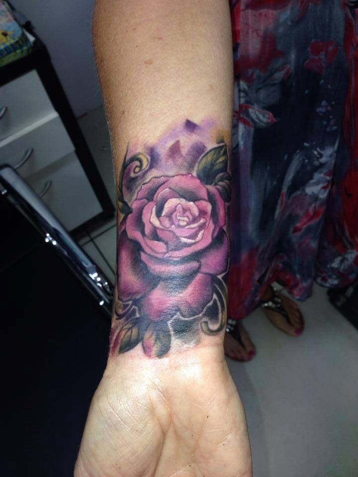 Rose wrist tattoo, not a massive fan of the purple, but I like.