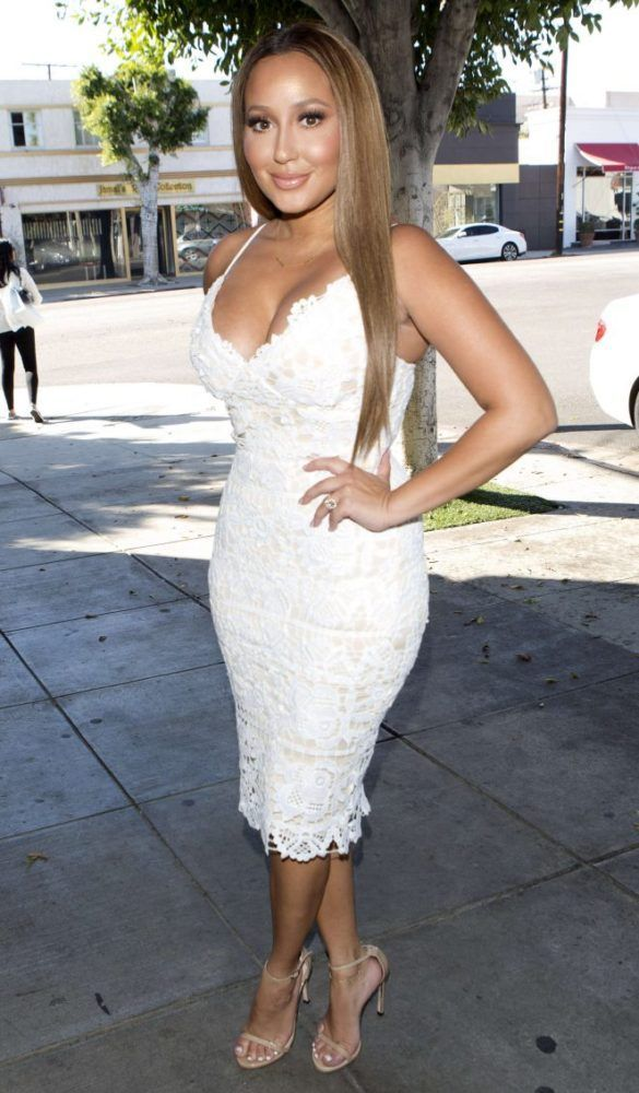 Adrienne Bailon celebrated her wedding shower in a $68 Missguided White Strappy Lace Midi Dress:  Her LWD features nude lining, a white floral lace overlay, v-neckline, and delicate straps.  So cute!