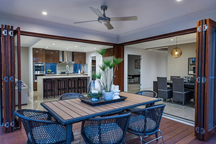 #Alfresco #design #ideas from Ausbuild's Newbury display #home. www.ausbuild.com.au. Entertain all year round with this airy and protected #alfresco #area. #Rattan chairs and large open #doors give a resort style feel.