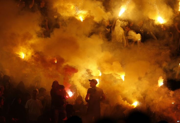 April 26, 2015 Partizan soccer fans light torches during a Serbian National soccer league derby match between Red Star and Partizan, in Belgrade, Serbia, April 25, 2015.