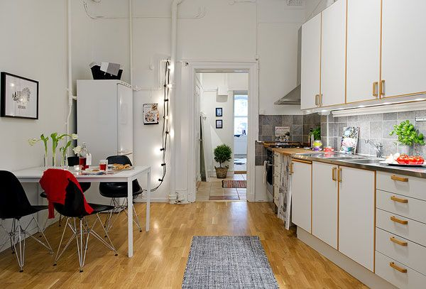 Color, Simplicity and Function in a Small Scandinavian Crib - http://freshome.com/2011/11/24/color-simplicity-and-function-in-a-small-scandinavian-crib/