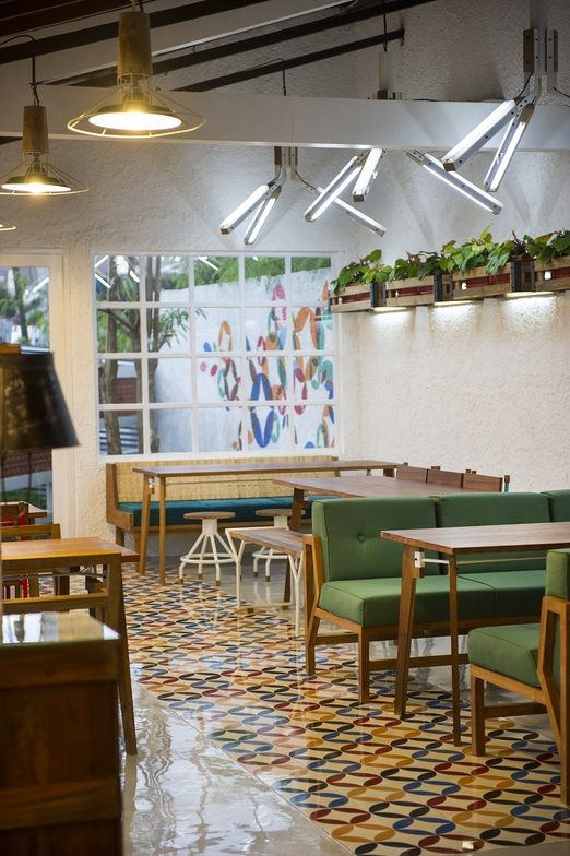 Stylish and homey: LOKAL Restaurant's simple yet attractive combination of wood and rattan furniture, open kitchen and g...
