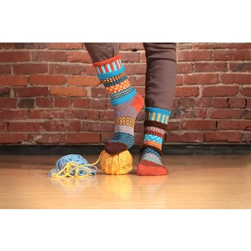 Richly-hued and immediately pleasing to the eye, Amber Sky Socks are reminiscent of the marvelous colors of the autumn horizon. Colors in this sock: