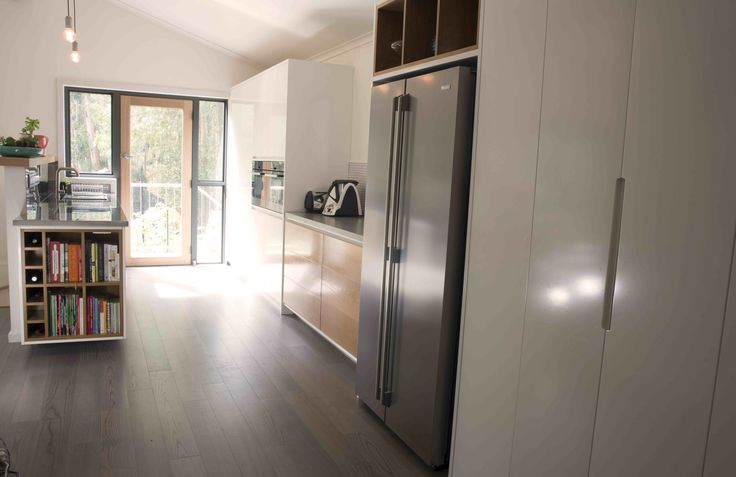 Kitchen using timber, stainless steel and Concrete
