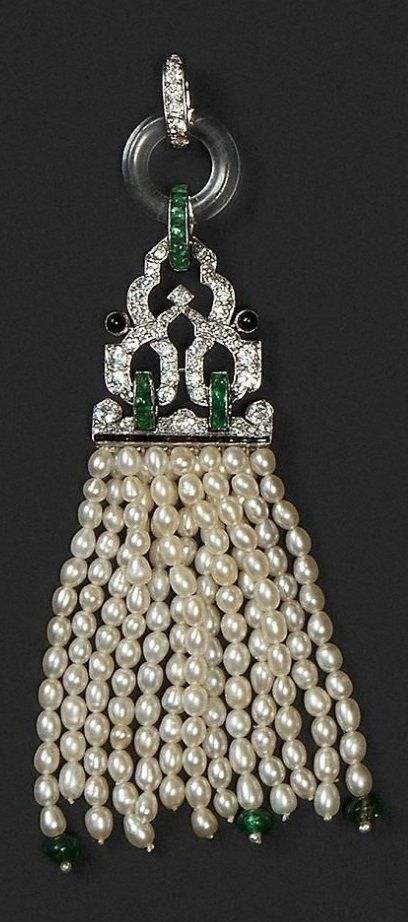 CARTIER - An Art Deco platinum, diamond, pearl, emerald, onyx and rock crystal pendant, circa 1925. Unsigned, numbered.