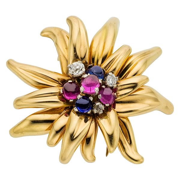 Retro Diamond, Ruby, Sapphire, Gold Clip-Brooch, Cartier, French The brooch features European-cut diamonds, enhanced by oval and round-shaped ruby and sapphire cabochons, set in 18k gold, marked Cartier, Paris, French hallmarks