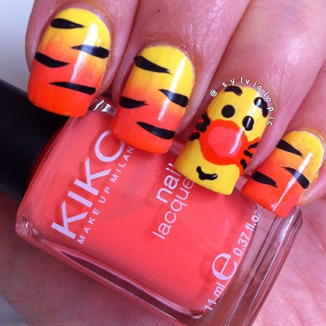 Instagram media by sylvialopic - Tigger design!  Some fun nails while I'm away from the office for a couple of days enjoying the Melb cup long weekend