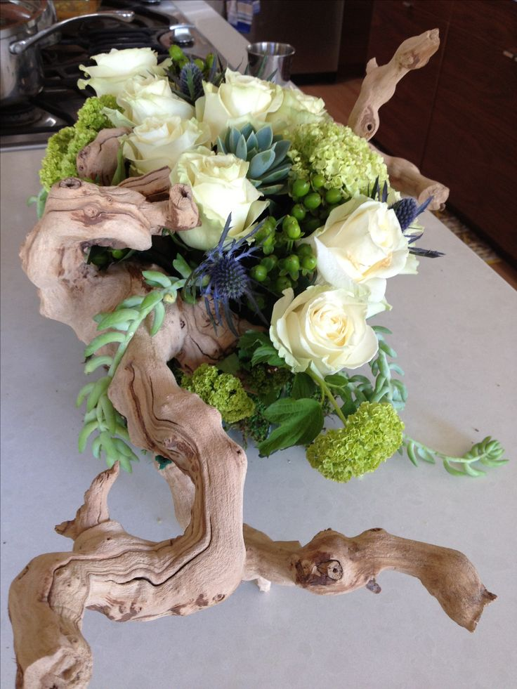 Driftwood floral arrangement Grapewood succulent wedding centerpiece