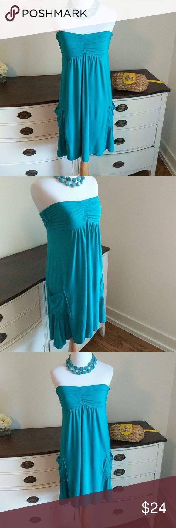 Turquoise American Rag dress with pockets! Super cute and flattering American Rag dress. American Rag Dresses