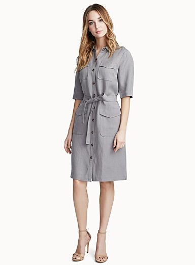Exclusively from Contemporaine     An elegant utilitarian-style dress we adore, featuring four large flap patch pockets at the front   Matching tie belt that beautifully flatters the waist   Woven in a soft natural linen-lyocell blend with a light and comfortable quality, ideal for summer    The model is wearing size small    Length: 99cm, from the top of the shoulder