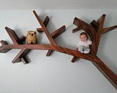 I like these shelves, but I'm also weirded ouy by the fact that there's a tiny baby sitting on one of the branches. Either way, the shelves are cool.