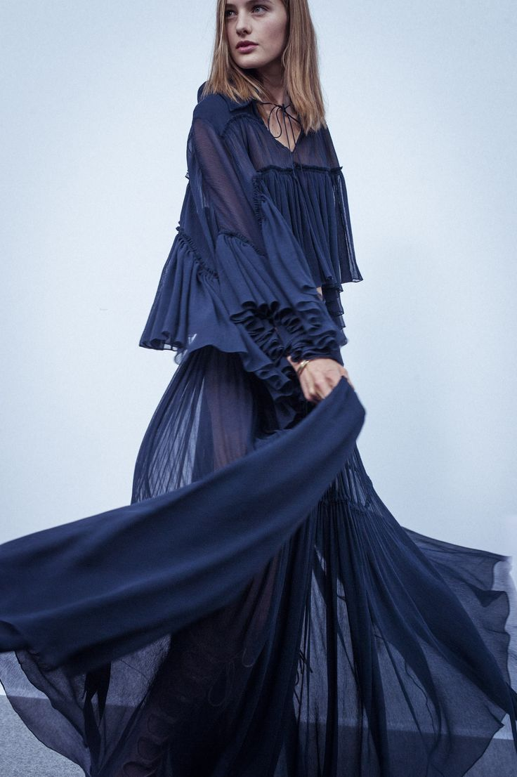 Exaggerated gauzy volumes create movement backstage at the Spring-Summer 2015 runway