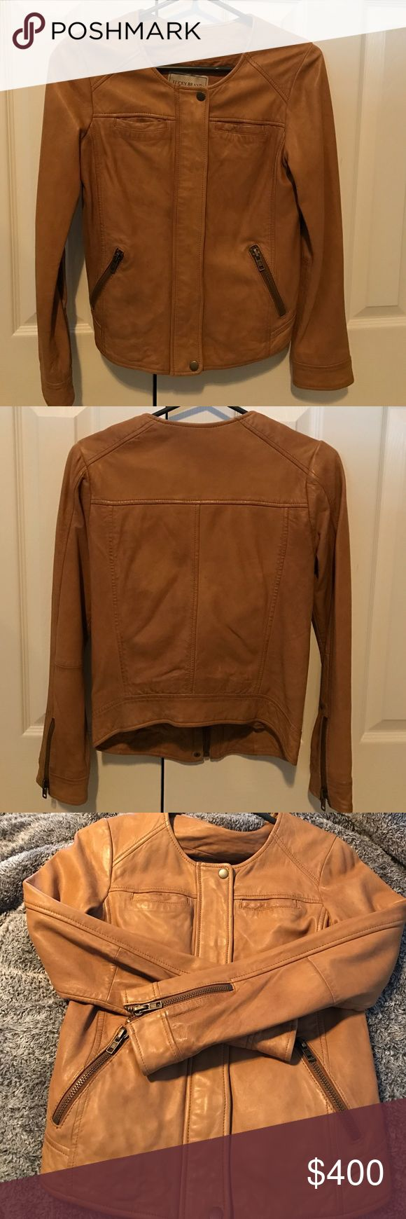 Lucky Brand camel leather bomber jacket NWT XS Gorgeous buttery soft leather bomber Jack with zip up front and snap closures. Zipper cuffs and front zip pockets. This jacket is brand new with tags attached. Just gorgeous!!!! Lucky Brand Jackets & Coats