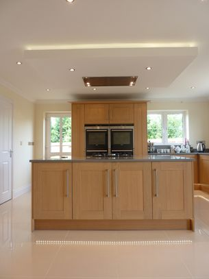 Suspended ceiling with lights and flat extractor hood over ...