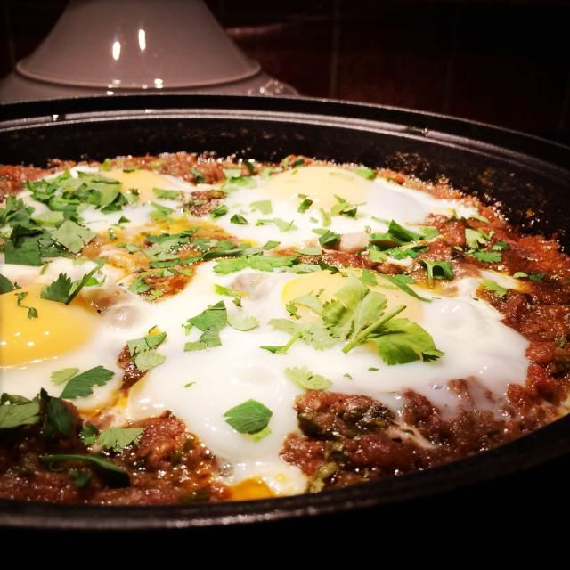 Recipe for Tagine Kefta Mkaouara – Moroccan meatballs cooked in a spicy tomato sauce. Eggs are an optional but classic addition to this dish.