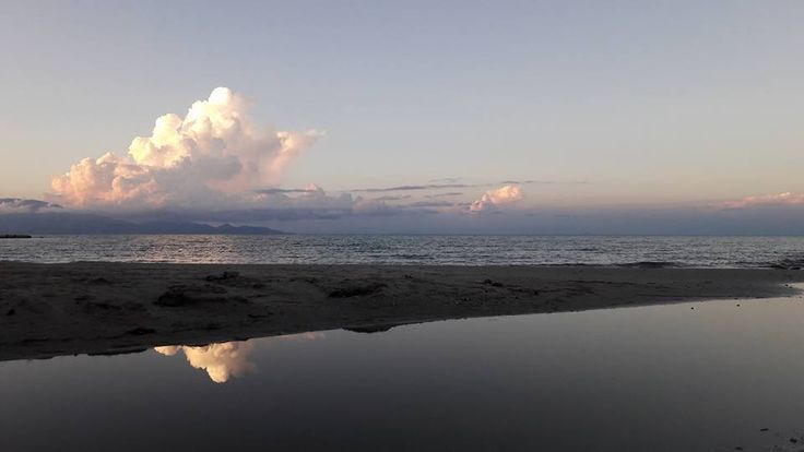 Alykes beach as photographed during sunset. This beautiful sandy beach is ideal for families with children, since the water is shallow, warm and crystal clear.