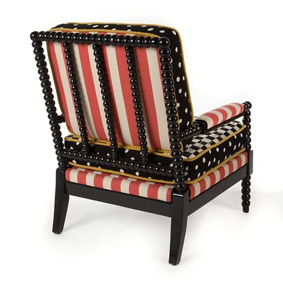 Spindle Cabana Outdoor Chair: Spindle Cabana Outdoor Chair: We love reinterpreting the classics—with a bold attitude, of course. We started with rugged-yet-chic black resin frames inspired by their namesake furniture style, and dressed them up in Sunbrella outdoor cushions in eye-catching black, white, and poppy red. Equally stylish on the lakeside deck of a beloved family camp as in a urban townhouse sunroom, this suite brings the indoors out with panache.