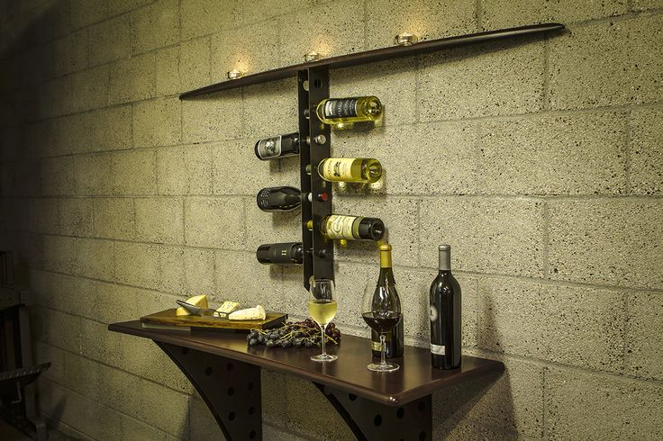 A beautiful & functional wine & cheese serving station with tea light candle shelf and integrated bottle storage. This set holds and displays up to 34 bottles of wine in the laser-cut steel table & shelf supports.The table and shelf are machined from 22-ply finland birch in an hourglass shape with a 1.250 radius and are finished with a custom stain & satin clear coat…