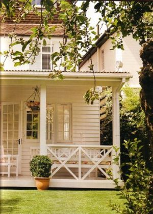love the little back porch on this country home  Luscious outdoor living - mylusciouslife.com - White weatherboard cottage.jpg