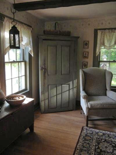 A corner cabinet with an old door is soo awesome!
